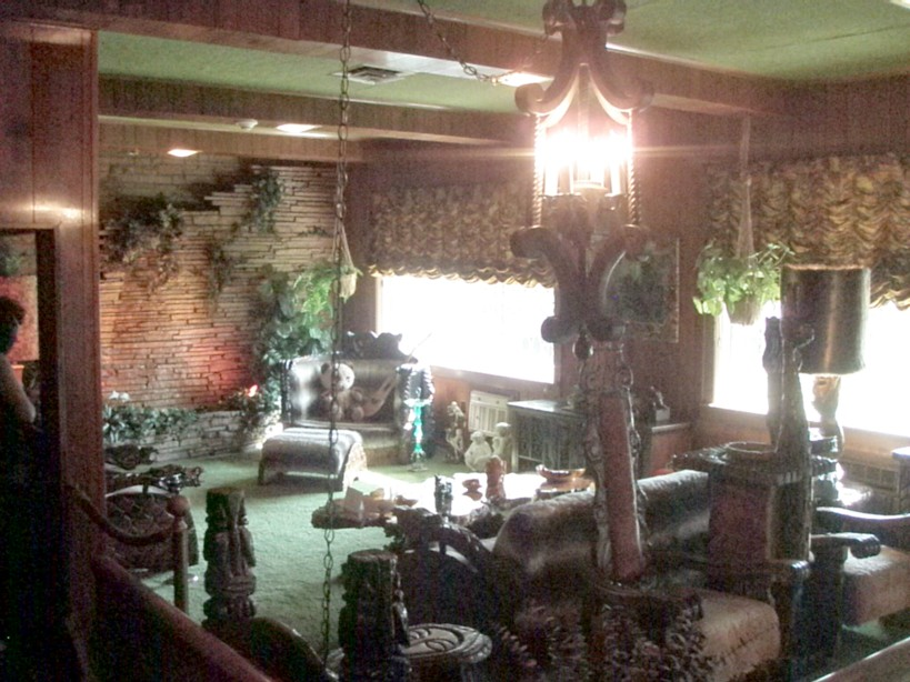 Elvis' Jungle Room, complete with green shag carpet and monkeys.