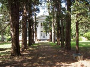 The Cedar Walkway invites visitors into Rowan Oak